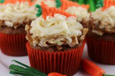 Carrot Cake Cupcakes with Cream Cheese Frosting - Carrots and cinnamon combine in a moist and delicious cupcake topped with to die for cream cheese frosting. This cupcake tastes just like Carrot Cake which makes it a great Easter Dessert idea or Spring Brunch treat. Pin this delicious carrot cake cupcake recipe for later and follow us for more great Easter Food ideas. #EasterDesserts #EasterTreats #EasterFood #CarrotCake #Cupcakes