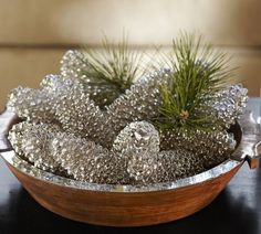 Spray paint pine cones to have that mercury glass look to them. Use Krylon Looking Glass Mirror-Like Paint on pinecones, add a little fresh or faux greenery to accomplish this look.*** this link really doesn't tell you how to do this, but it's pretty self explanatory (try adding some white twinkle lights in the bowl or apothecary jar!) Childrens Christmas Crafts, Holiday Crafts, Christmas Decorations For The Home, Holiday Ideas, After Christmas, Christmas 2014, Gold Christmas, Xmas, Pinecone Ornaments