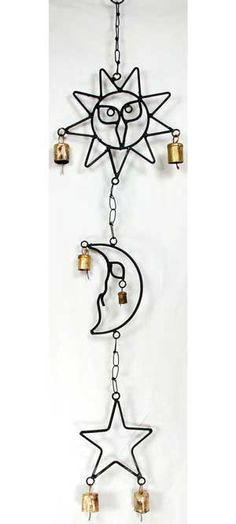 Crafted of wrought iron, this wind chime links together three icon images of a sun, a moon, and a star. Each features two copper bells that ring with a light, jingling music.