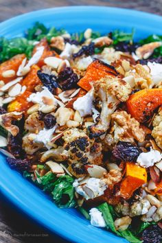 Easy roasted butternut squash and cauliflower salad with kale and spinach.
