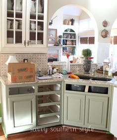 Savvy Southern Style: Kitchen Cabinets Tutorial — author used chalk paint, lacquer, and translucent color glaze