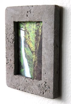 The Concrete picture frame, durable and manly! Perfect for your man cave or workshop, comes with instructions!