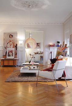 Zigzag wood floors+crown molding+unhung art+modern furniture