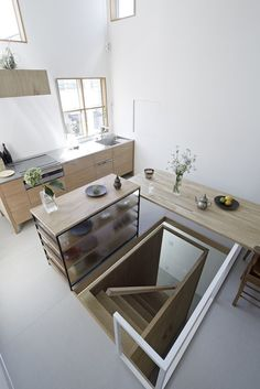Itami House by Tato Architects, floating wood table | Remodelista