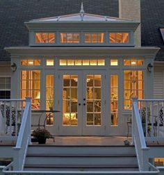 A small glassed in veranda that can double as a sunroom or mud room depending on the weather!