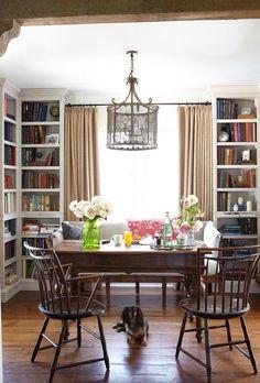 love the floor to ceiling bookshelves