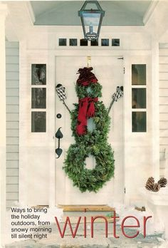 Welcoming front door.  Wreath snowman is genius.