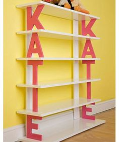 Name Shelf-  great inspiration to make one for your kid's room. Paint some wood letters or another idea could be to paint some paper mache letters and use as book ends too!