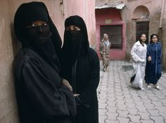 """Two jewelry peddlers wear veils to attract the attention of customers in Marrakech's medina, or old town. Younger Moroccans typically prefer Western dress now, wearing traditional clothing only on special occasions. This photograph appeared in """"Out of This World in Morocco,"""" a story in the winter 1988-89 edition of Traveler magazine. Photograph by Steve McCurry, October 19, 2014"""