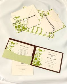Green Floral Silhouette Invitation Kits from https://www.weddingbellinvitations.com/categories/3-pocket-folder-kits/products/132-green-floral-silhouette-invitation-kits