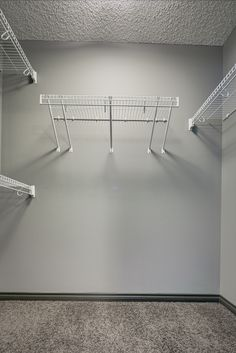 A walk in closet with freeslide wire shelving - a cost effective way to organize all your clothes! Custom Closet Design, Custom Closets, Walk In Wardrobe, Walk In Closet, Organizing, Organization, Master Bedroom Closet, Small Closets, Wire Shelving
