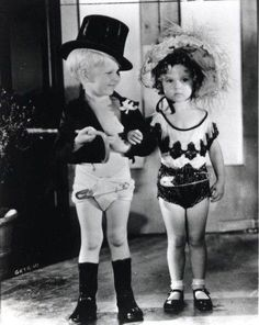 Shirley Temple and Jackie Cooper in the 1930's.