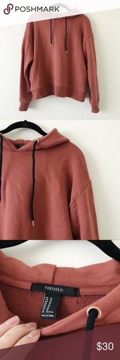 Rust Thick Hooded Sweatshirt • brand: forever 21  • condition: worn once for a few hours, like new  • size: medium  • description: very thick material hooded sweatshirt. super high quality! kangaroo pockets on back.   bundle to save 💵! no trades/holds/try-ons. will try to answer all questions asap. no price negotiations in comments.  ✨happy shopping!✨ Forever 21 Tops Sweatshirts & Hoodies