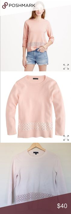 J.Crew Lace Hem Sweater J.Crew blush pink lace hem sweater. Cute eyelet cutout toward bottom of sweater. Sweater is more of a pretty blush pink compared to the stock photo. Size small. Great condition but does have small pink marks (see pic 4). Not sure what marks are from and it almost seems like shirt color pooled here during wash. Retails for $118.00. Sold out! Bundle to save 20% J. Crew Sweaters Crew & Scoop Necks