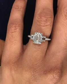 Very high quality Tacori engagement ring with emerald cut diamonds. Dantela collection in 18k white gold with 1.56 ctw diamonds. The center diamond is a 1.01 ct emerald cut, and it is beautiful. VVS2 clarity and F-G color. I can't tell you how good this looks in person. The clarity and color are fantastic! Clarity is especially important for emerald cuts, since it can be very easy to see inclusions due to the large facets. This one is just really, really clean, and it was the no-brainer c...