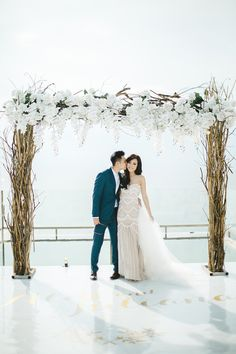 White floral arch takes centre stage in this Bali wedding on a floating platform // Magical Bali Wedding on a Floating Stage: Aldi and Juliana Barbados Wedding, Phuket Wedding, Bali Wedding, Wedding Stage, Wedding Ceremony, Wedding Arches, Sunset Wedding, Wedding Set, Wedding Flowers