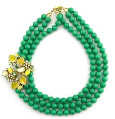 Great statement necklace. I love that vibrant green color.