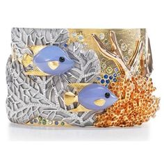 TIFFANY & CO | Angel fish cuff with diamonds, blue chalcedony, spessartite, blue and green sapphires and onyx in 18k, yellow, white and rose gold. | {ʝυℓιє'ѕ đιåмσиđѕ&ρєåɾℓѕ}