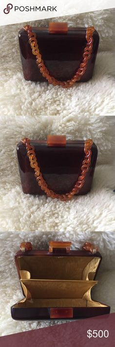 Vintage Estate 1950's era hard shell handbag. Vintage Estate 1950's era hard shell handbag.  Tortishell hard molded plastic lined in golden cloth. This handbag is the very same style the icon Jackie Kennedy carried in her hay-day. Excellent pre-owned condition. Bags Mini Bags