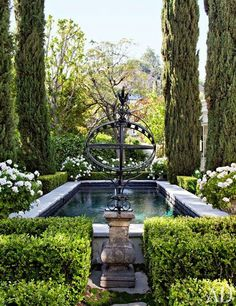 Wade Graham Doheny A formal-but-sensual garden of linked small spaces for a gorgeously-restored 1950s John Woolfe hideaway in the Hollywood Hills. Gem-sized swimming pool, Italian cypresses, climbing roses, box hedges, and a flowering palette of green and white.