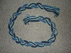 "Woven mystery braid by flufdrax on DeviantArt""  I warped up a strip out of yarn and wove the piece connected at the top and bottom end but with gaps dividing it vertically along the remainder of its length. After I cut the piece off the loom I mystery braided the middle section and ended up with a strip about 5 feet long.""  Wonderful!"