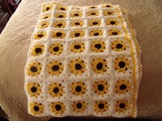 Adorable yellow sunflower crochet baby by ChevronLane on Etsy This is an adorable blanket made up of sunflower squares. Use it to keep your baby warm, baby shower gift or it would be great as an accent piece. It measures approximately 31 Sunflower Nursery, Sunflower Room, Sunflower Baby Showers, Crochet Sunflower, Yellow Sunflower, Crochet Mandala, Easy Knitting Projects, Crochet Projects, Baby Blanket Crochet
