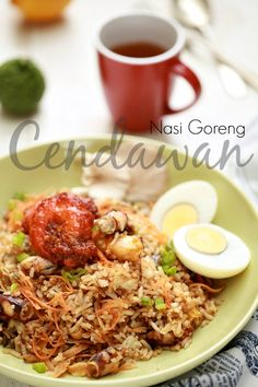 Malay Nasi Goreng; a meal including stir fried rice in small amount of cooking oil or margarine, typically spiced with kecap manis (sweet soy sauce), shallot, garlic, tamarind and chilli and accompanied by other ingredients, particularly egg, chicken and prawns.