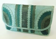 99f4521a57f5 Carlos Falchi Teal Green Clutch. Get the trendiest Clutch of the season! The
