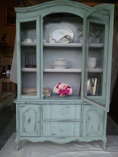 Awesome blogspot-Rustichic. She repurposes used furniture. Transformed this French Hutch into this.