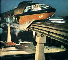 The Disneyland Alweg Monorail glides above the stealthful Submarine Voyage.