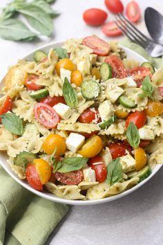 Pesto Pasta Salad with fresh tomatoes, mozzarella and pesto. An easy summer side dish with only 5 ingredients! | Tastes Better From Scratch   Happy Memorial Day! Hopefully you're spending the day with family, remembering loved ones who've passed on and enjoying beautiful weather and BBQ's!  Side dishes like this Pesto Pasta Salad become staples throughout the summer …