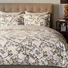 Aviary Duvet Cover | Blithe and crisp, our Aviary duvet cover is a fresh take on the timeless bird motif. Hand-drawn in our studio, this graphic, airy design infuses the room with effortless style. The palette of ink, smoke and citrine give this duvet its modern sensibility.