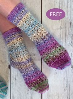 Free Knitting Pattern for 6-Row Repeat Tiptoe Tulip Socks - Cuff down, heel flap socks knit in a 6 round repeat tulip lace stitch. 3 Sizes: S Small (medium, large) adult foot 19cm (21.5cm, 24cm), 7½(8½, 9½) in. Fingering weight yarn. Designed by Josie Kitten for Stylecraft. A kit is also available.