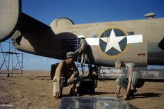 A view as crew members of the 376th Bombardment Group work on a B-24-Liberators at the U.S Air Force Base in Benghazi, Libya.
