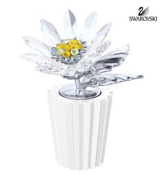 Symbolising purity and love, this daisy flourishes in clear crystal and will never lose its sparkle. Sparkling elements in Light Topaz and Jonquil. Shop now Swarovski Ornaments, Swarovski Crystal Figurines, Swarovski Crystals, Glass Figurines, Collectible Figurines, Crystal Decor, Clear Crystal, Kingfisher Bird, Little Gardens