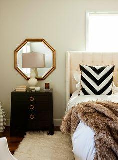 upholstered bed, black nightstands, octagon mirror