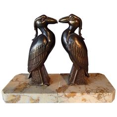 Pair of Art Deco Bronze Bird Bookend by Jamar | From a unique collection of antique and modern sculptures at https://www.1stdibs.com/furniture/decorative-objects/sculptures/