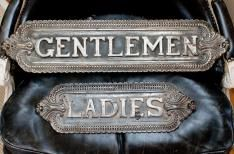 Paris Hotel Boutique. Pair of antique cast iron theatre signs. It's my dream to have separate bathrooms some day. Downstairs for the ladies and upstairs for the gentlemen... I love the selection of elegant antiques on this site.