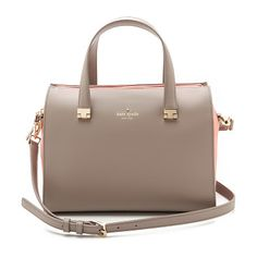 The muted color of this Kate Spade New York satchel is highlighted by contrast suede trim and gold tone hardware.