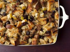 Barefoot Contessa's Sausage and Herb Stuffing : Sweet and savory, Ina's stuffing is bursting with fall flavors, with tart apples and dried cranberries mixed with savory sausage. You can use white or sourdough bread, but Ina likes using a French boule, a traditional round loaf.