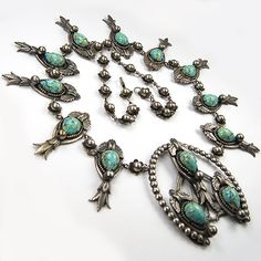Joseff of Hollywood Silver Flowers and Crests and Teardop Marbled Turquoise Cabochons Horseshoe Pendant  1938-1942  Necklace