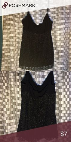 Black tank top Top is stretchy black material, the bottom glittery part has a black under layer and the glittery part is semi see thru. Great condition. Tops Tank Tops