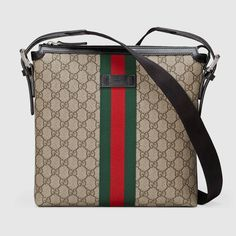f773a6cbde259f Shop the Web GG Supreme messenger by Gucci. A slim messenger bag made in our