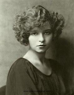 This is a very young Mae West! Born in 1893, I'm guessing that this photo might be sometime around 1913, perhaps when she was 20... she looks a little younger than 20, but I am just guessing here.  (1920  I love her hair)
