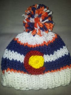 style: fitted custom CO flag beanie colors: bronco colors [blue/orange/white] size: adult Broncos Colors, Mountain Hat, Beanies, Blue Orange, Fiber Art, Hand Knitting, Headbands, Colorado, Flag