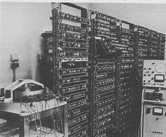 The Manchester University experimental transistor computer, operational in November 1953 and therefore the world's first transistor stored-program machine to work. The magnetic drum store on the left of the photograph was re-cycled from an earlier computer project.