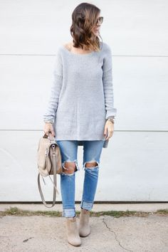 Casual style with an oversized sweater and distressed denim