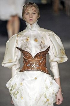 McQueen... is that a leather corset I spy?