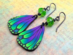 Feathery Fade Stunning Handmade Polymer Clay Wing Earrings. $12.00, via Etsy.