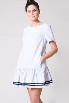 One of our cutest, most comfortable dresses yet! Lightweight, blue striped shift dress with an on trend ruffled hem and striped details on bottom. Short sleeves, round neckline, and pockets on side. Cute tie detail on back. Pair with some espadrilles for a chic, effortless look! Olivia Striped Ruffle Dress